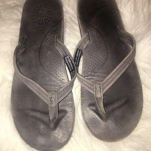 UGG • leather flip flops
